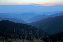 Sunny dawn on the mountain slopes Stock Photos