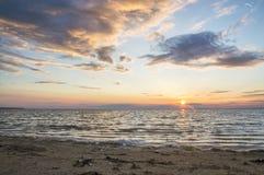 Sunny dawn sea, foam on the shore Stock Photo