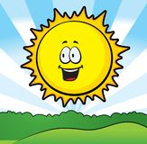 Sunny Day. A smiling sun above a green field Stock Images
