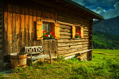 Traditional house into the Alps Stock Photo