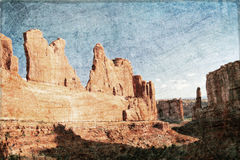 Sunny day in Arches Canyon in grunge style Royalty Free Stock Photo