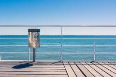 Sunny Day Beach Dock Trash Can Railing Blue Sky Wood Landscape V Stock Photo