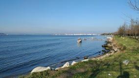 Sunny day on the beach. Sky blue sea blue stock image