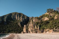 Cirali nature panorama. Virgin beach, green mountains, skyline. Sunny day at the beach. Wild life, untouched by civilization, still as beautiful as million Royalty Free Stock Photos