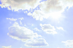 Sunny day - beautiful blue sky with shining sun and clouds Stock Photo