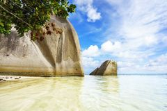 Big granite rocks in turquoise water at tropical beach,paradise. A sunny day. Big granite rocks in turquoise water at tropical beach,paradise in la dique Stock Photos