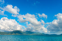 Sunny day with blue cloudy sky at tropical green island Stock Photography