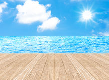 Sunny day with blue sky at sea on wooden pier Royalty Free Stock Photo