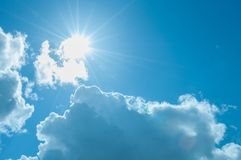 Fluffy white clouds and blue summer skies. A sunny day with a blue sky and some fluffy cumulus clouds stock photo