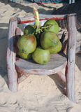 Sunny day bunch coconut on wood chair. At Phuket Royalty Free Stock Photo