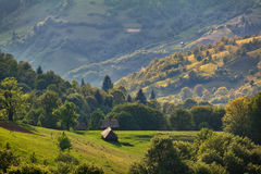 Sunny day in carpathian mountain village. Sunny spring day in carpathian mountain village Royalty Free Stock Photography