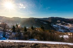 Sunny day in Carpathian mountains. Lovely winter landscape with small amount of snow Stock Photos