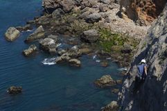 Sunny day of climbing on stone cliffs in Portugal with climbers royalty free stock photos