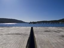 Sunny day at Coniston Water, Cumbria, from jetty Stock Images