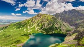 Sunny day at Czarny Staw Gasienicowy in summer, Tatras. Europe Royalty Free Stock Photos