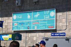 Dodger Stadium - Los Angeles Dodgers. A sunny day Dodgers baseball game at classic Dodger Stadium in Los Angeles, California. A concession stand sign Royalty Free Stock Photo