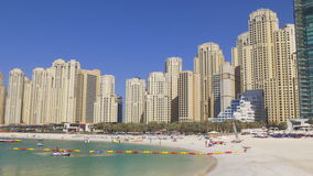 Sunny day dubai marina jbr block beach panorama 4k uae. Uae sunny day dubai marina jbr block beach panorama 4k stock video