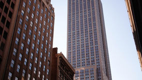 Sunny day empire state building view 4k time lapse from new york stock video footage