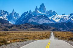 Sunny day in February in Argentine Patagonia. Fine concrete highway to the majestic Mount Fitz Roy. Sunny autumn day in February. Argentine Patagonia royalty free stock image