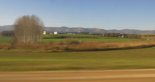 Sunny day field and mountain train window view 4k spain. Spain sunny day field and mountain train window view 4k stock footage