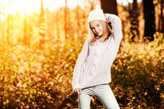 Sunny day in forest. A portrait of a pretty young girl in the sunny forest. Autumn fashion, beauty royalty free stock image