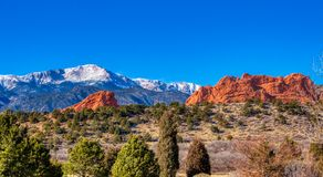 Sunny day at Garden of the Gods with Pikes Peak and Kissing Camels stock image