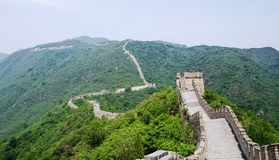 Sunny day at the great wall of China. The Great Wall of China is a series of fortifications made of stone, brick, tamped earth, wood, and other materials Stock Photo