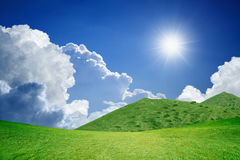 Sunny day, green hills Royalty Free Stock Photo