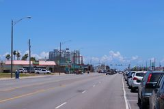 Urban street scene in Texas, United States of America. Boulevard in Galveston, Texas, Lone Star State. A sunny day on the Gulf Coast of Texas, United States Royalty Free Stock Images