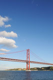 Sunny Day with Half Moon and Red Suspended Bridge Royalty Free Stock Image