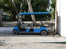 Blue Golf cart on a sandy beach in Maldives royalty free stock photography