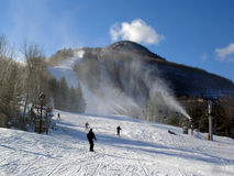 Sunny day on Hunter Mountain ski resort, NY. Snowmaking in action royalty free stock images