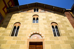 Sunny day italy church tradate  entrance and windows  mosaic Stock Photo