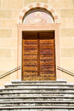 Sunny daY italy church tradate    the old door entrance  mosaic Stock Photos