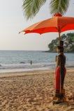 Sunny day at Kamala beach on Phuket Thailand. Umbrella and a statue. Stock Photography
