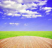 Sunny day with landscape. And wood terrace Royalty Free Stock Photo