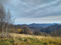 Sunny day of late autumn in the mountains royalty free stock images