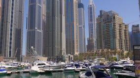 Sunny day light dubai marina yacht dock panorama 4k uae. Uae sunny day light dubai marina yacht dock panorama 4k stock video