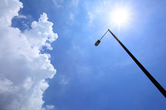Sunny day with lighting pole Royalty Free Stock Photos