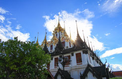 Sunny day at Loha Prasat,Wat Ratchanaddaram Woravihara. Wat Ratchanaddaram Woravihara(Loha Prasat) is a  buddhist temple located at the intersection between Royalty Free Stock Photos