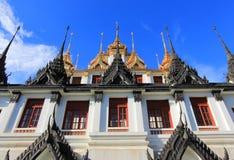 Sunny day at Loha Prasat,Wat Ratchanaddaram Woravihara Royalty Free Stock Image