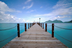 Sunny day at Long Jetty with turquoise water. Sunny day at Borneo island; long Jetty with turquoise water near Sipadan Island in Semporna, Bohey Dulang Island Royalty Free Stock Photography