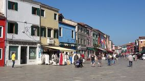 Sunny day on the main street of Burano. Venice, Italy stock video footage