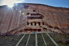Mati Temple in Gansu province in China and the prayer flags hung in the foreground. Sunny day in Mati Temple in Gansu province in China and the prayer flags Royalty Free Stock Photos