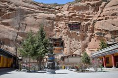 Mati Temple in Gansu province in China and the prayer flags hung in the foreground. Sunny day in Mati Temple in Gansu province in China and the prayer flags Stock Photography