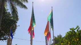 Sunny day miami downtown bayside colorful flags 4k florida usa. Usa sunny day miami downtown bayside colorful flags 4k florida stock video