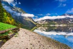 Sunny day at a mountain lake Stock Image