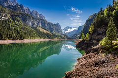 Sunny day at mountain lake in Gosau, Alps, Austria, Europe. Sunny day at mountain lake in Gosau, Alps, Austria Royalty Free Stock Images