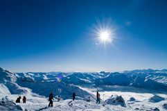 Sunny day in mountains. At the peak of the mountain Royalty Free Stock Image