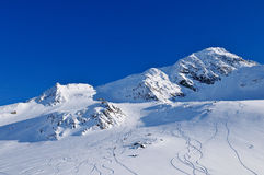 Sunny day in mountains after great freeride. Freeride area seen from the village Royalty Free Stock Images